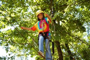 Happy Riverview Camp camper on sky ropes
