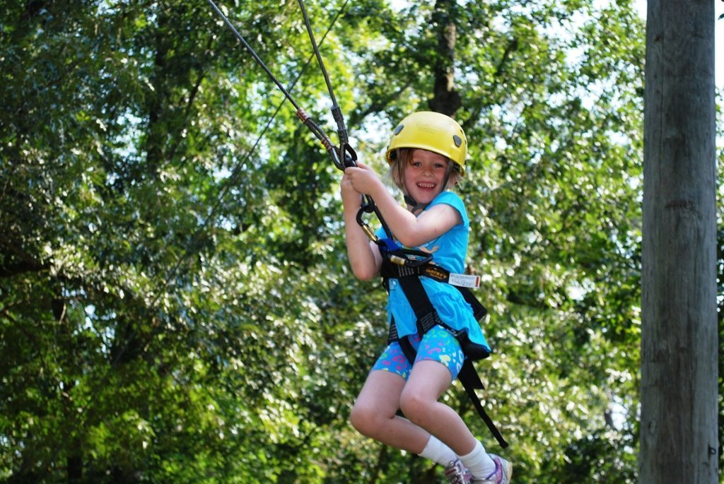 Happy Riverview Camp girl on zip line