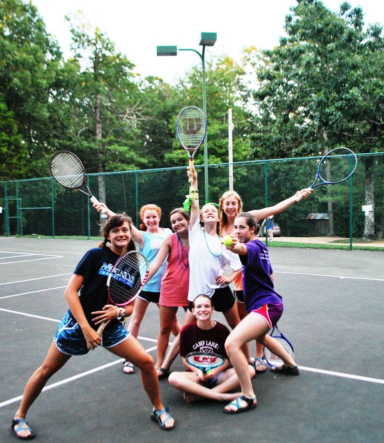 Group of happy tennis players